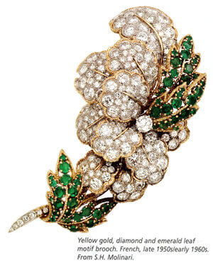 Diamonds and green emeralds leaf motif brooch