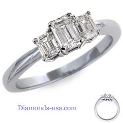 Emerald cut three diamond ring
