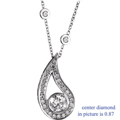 Drop pendant with surrounding diamonds