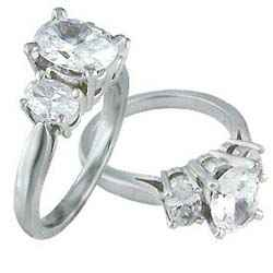 Oval cut three stone engagement ring
