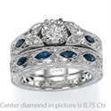 Picture of Hand engraved, vintage designers Engagement ring with blue Sapphires