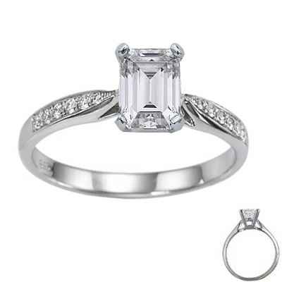 Cathedral engagement ring with side diamonds