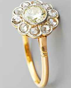 Vintage engagement ring with big diamonds in the halo
