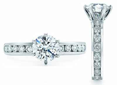 Designers model,6 prongs with channel set diamonds