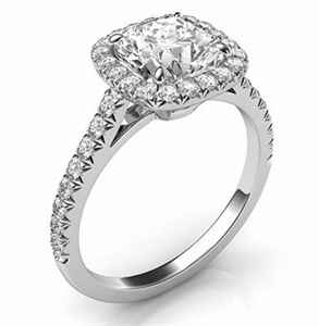 Cushion cut diamond set in halo engagement ring