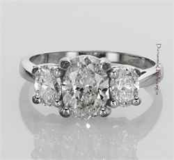 Three stone engagement ring with Oval diamonds