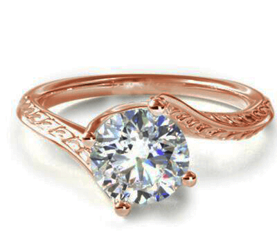 Vintage style wheet motif solitaire engagement ring