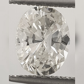 Picture of 0.85 Carats, Oval Diamond with Good Cut, I Color, SI3 Clarity and Certified By CGL