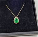 Picture of Emerald 6x8 mm pendant with diamonds